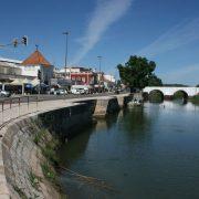 The River Arade glides through Silves town center