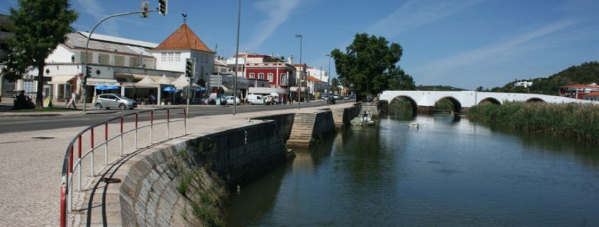 The River Arade glides through Silves town center